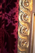 Closeup of the luscious velvet and gilding.